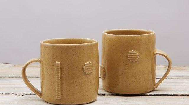 Pale Mustard Stoneware Mugs decorated with Cut out Shapes elizabeth-renton